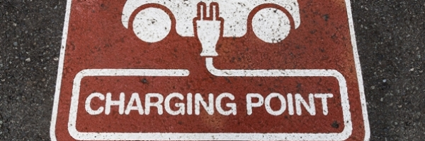electric vehicle quick charge sign on parking spot